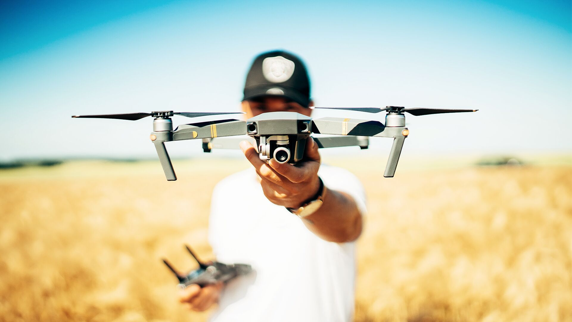 field_drone_with_camera_held_by_grower_in_field